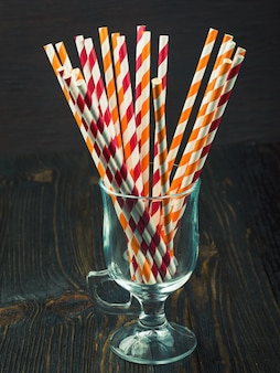 Striped straws for cocktails in a glass