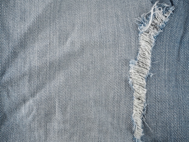 Striped textured old blue jeans denim and bit torn is fashion jeans design