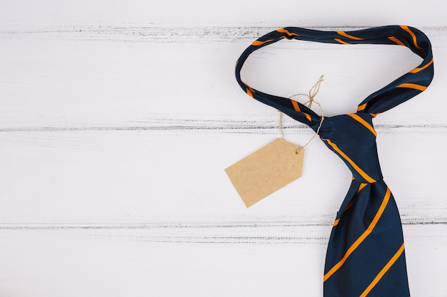 Striped tie with tag