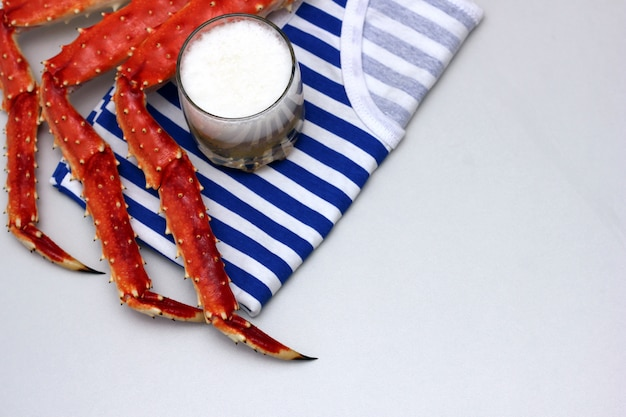 The striped vest and the cooked legs of the kamchatka king crab .