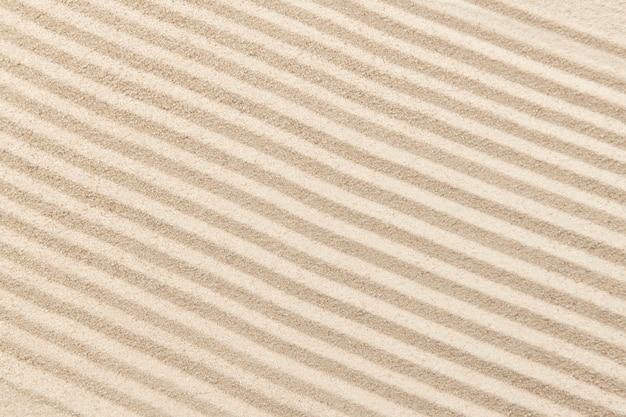 Sfondo di sabbia zen a strisce nel concetto di salute e benessere