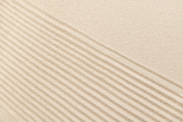 ウェルネスコンセプトの縞模様の禅砂の背景