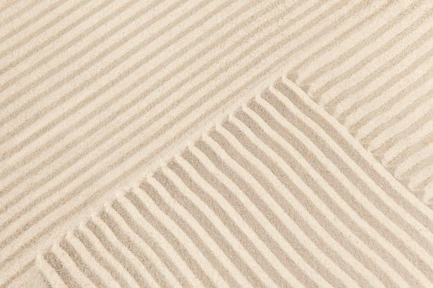 Sfondo di sabbia zen a strisce nel concetto di consapevolezza
