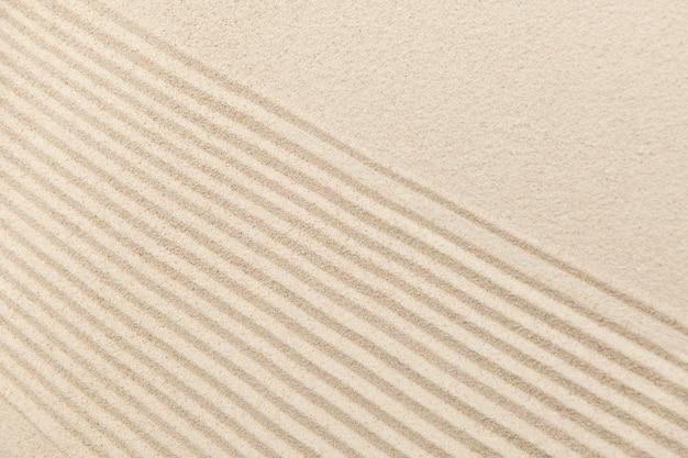 Sfondo di sabbia zen a strisce nel concetto di benessere