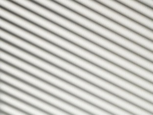 Stripes black shadow on white concrete background
