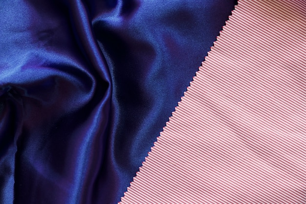 Stripes pattern textile on smooth blue cloth
