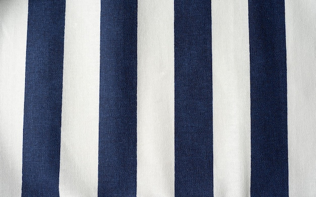 Stripped blue and white cloth linen napkin background top view