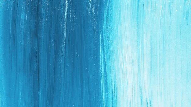 明るい青いペンキのストロークの背景