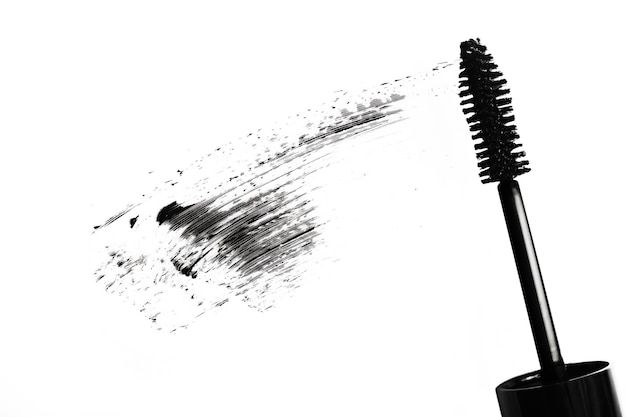 Stroke of black mascara with applicator brush.over view.smear of make up.isolated on white.background for design.