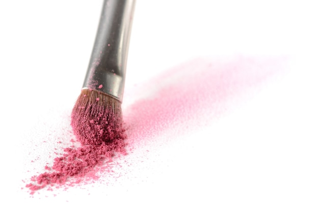 Stroke of eyeshadow made with a makeup brush on watercolor paper isolated on a white background