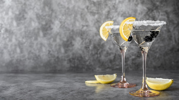 Strong alcoholic beverage with olives and lemon