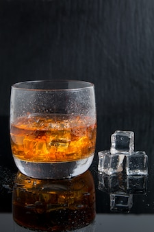 Strong alcoholic drink. whiskey with ice