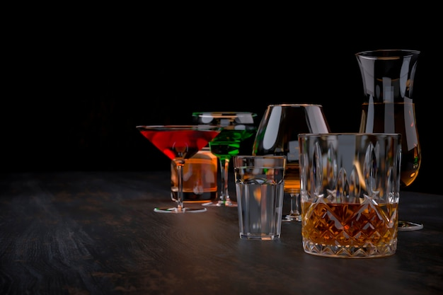 Strong alcoholic drinks on dark background