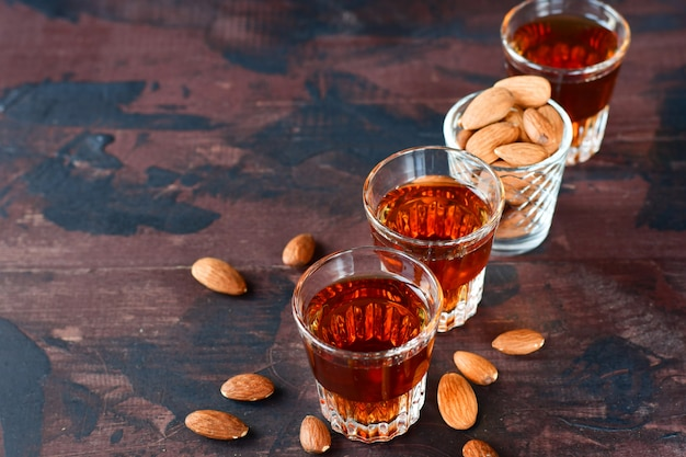 Strong alcoholic italian liqueur amaretto with almonds nuts