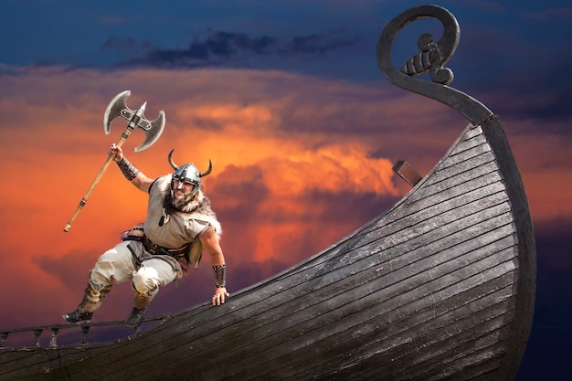 Strong angry bearded viking with axe jumping