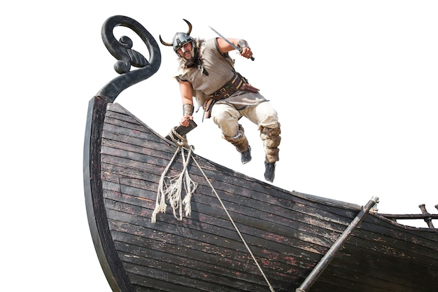 Strong angry bearded viking with knife jumping