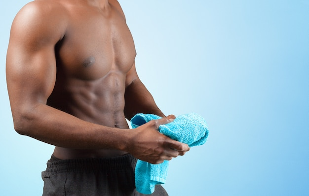 Strong athletic black man torso isolated close up