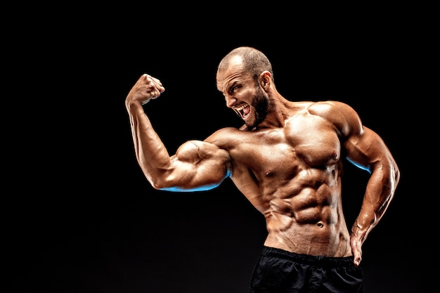 Strong bald bodybuilder with six pack.