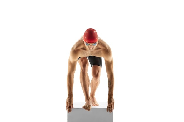 Strong. caucasian professional sportsman, swimmer training isolated on white