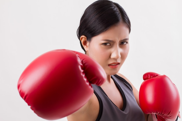 Strong fitness woman punching isolated