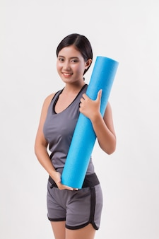 Strong flexible fitness yoga woman with yoga mat