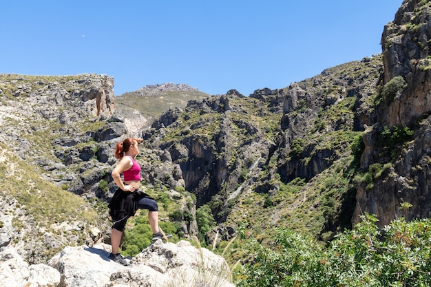 Strong girl at the mountain in sierra nevada