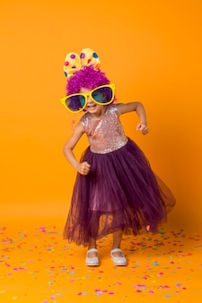 Strong girl with clown wig and tutu