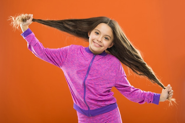 Strong hair concept. kid girl long healthy shiny hair. main thing is keeping it clean. use gentle shampoo and warm water. little girl grow long hair. teaching child healthy hair care habits.