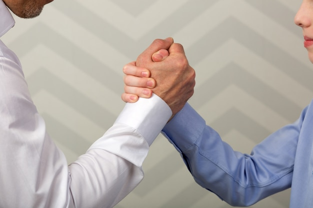 Strong handshake of father and son