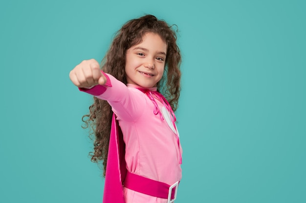 Strong little superhero ready to save world