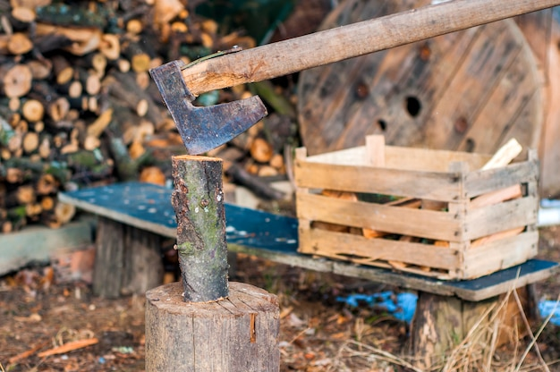 Strong lumberjack chopping wood, chips fly apart. ax, hatchet, axe. split a log with an ax. birch firewood in the background. wood wallpaper