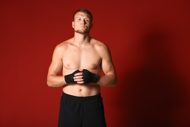 Strong male boxer on color