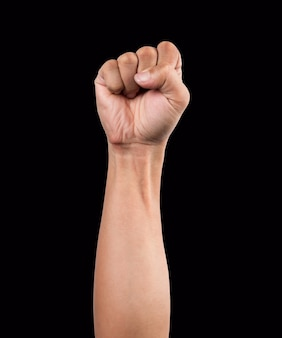 Strong male man raised fist on black background