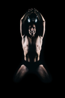 Strong man exercising with a kettlebell