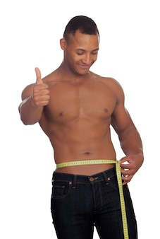 Strong man saying ok with a tape measure