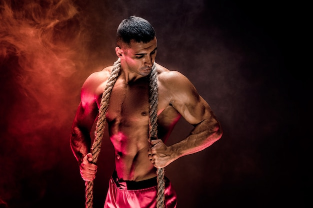 Strong man with rope