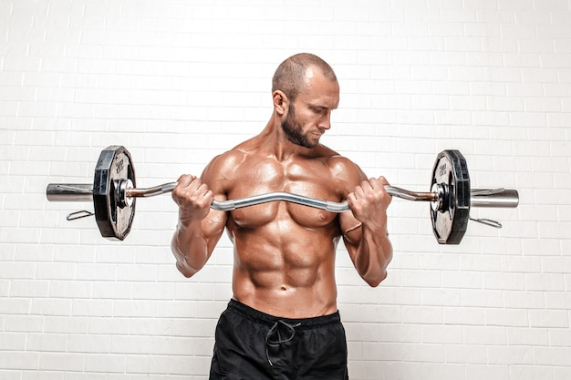 Strong man with weight bar