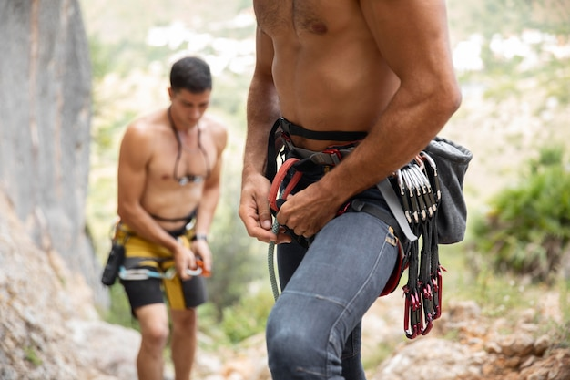 Strong men getting ready to climb