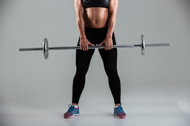 Strong muscular adult sportswoman