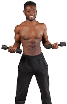 Strong and muscular guy with dumbbell isolated on white