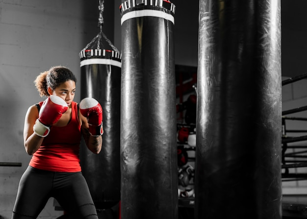 Strong woman training in boxing center