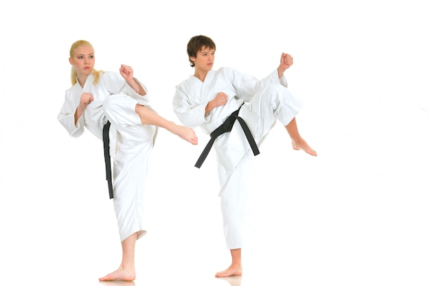 Strong young blonde girl and the saucy karate guy