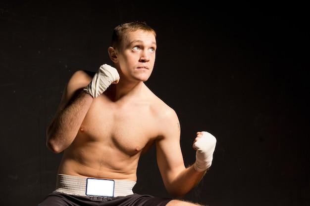 Strong young boxer seeking inspiration