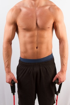 Strong young male exercising with his shirt off