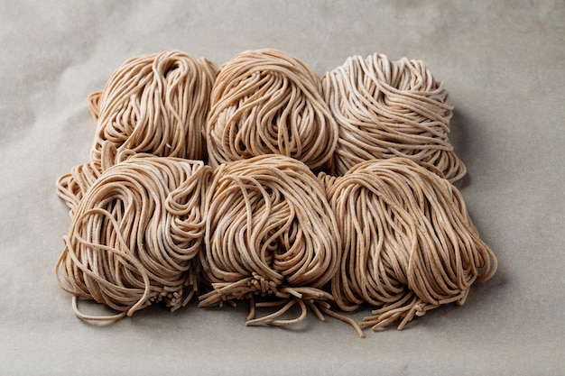 Strops of dry buckwheat noodle nests texture