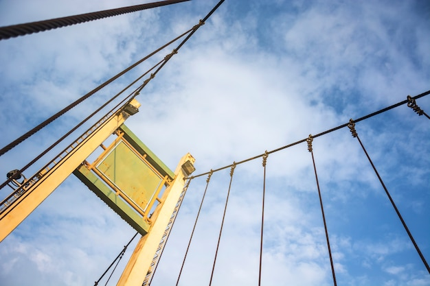 Structure of concrete poles and wire rope hanger bridge mount