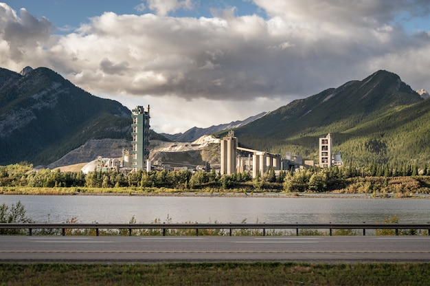 Structure millstone plant with ore mine in valley on waterfront