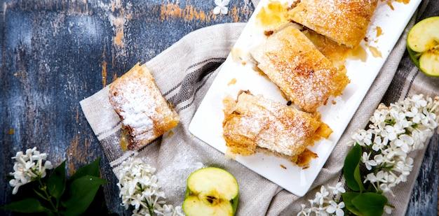 Strudel apple and sugar powder.