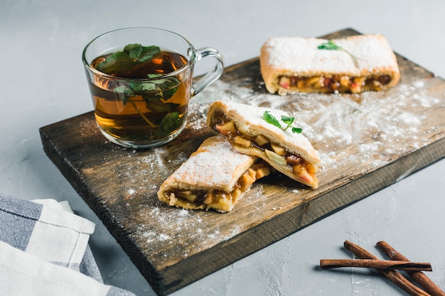 Strudel with peach and apple, cinnamon tea with mint