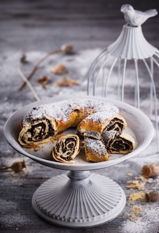 Strudel with poppy seeds on a vintage stand.
